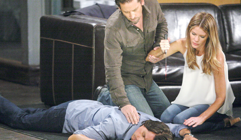Franco saves Nina (Michelle Stafford) after discovering her with Silas Clay's (Michael Easton) dead body (Sean Smith/JPI)