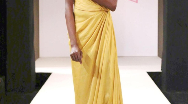 Spectra Fashion Show gold gown