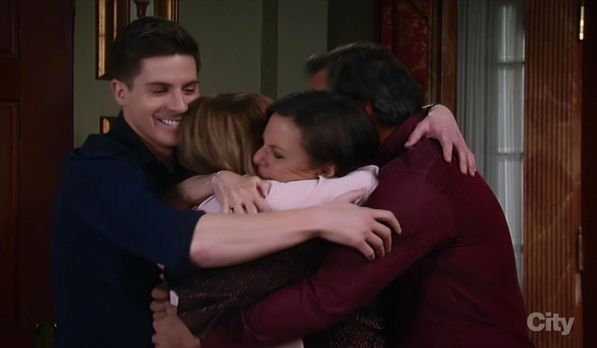 Tracy hugs her family goodbye