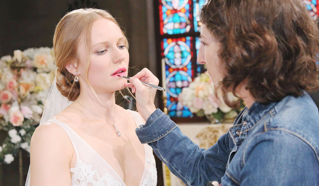 Marci getting lipstick done for double wedding