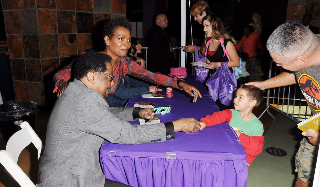 James, Vanessa and fans getting autographs at Day of Days 2017