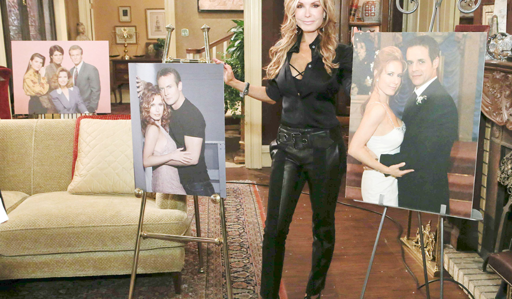 Tracey Bregman posing with posters of Lauren Fenmore...