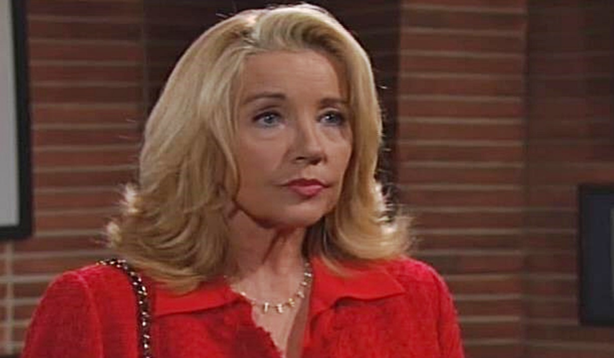 Nikki in red with pursed lips on the Young and the Restless