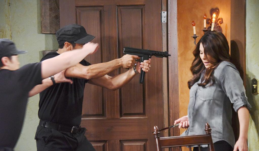 A gun is held to Chloe's head