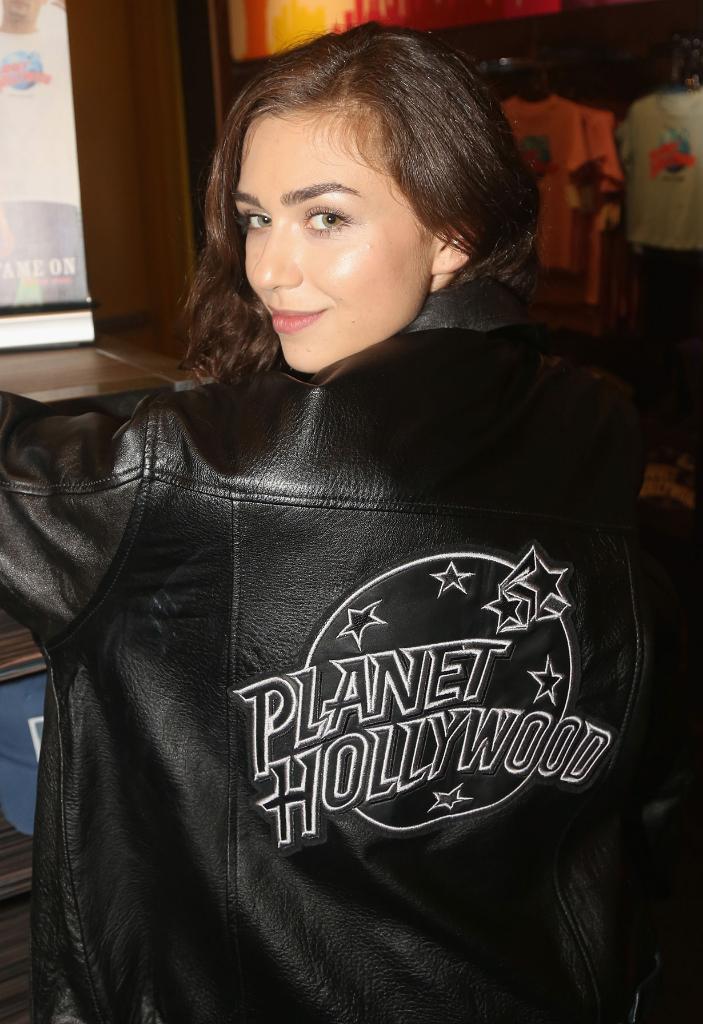 Victoria Konefal showing Planet Hollywood jacket logo