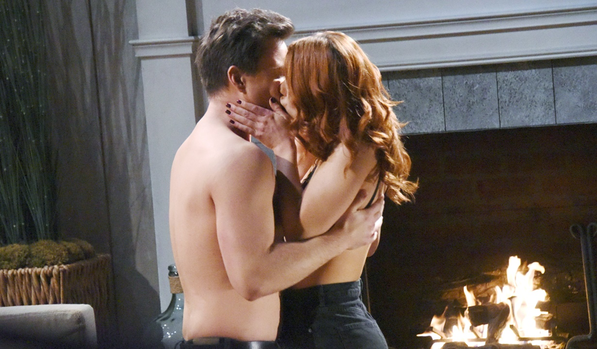 Wyatt and Sally kiss by the fireplace