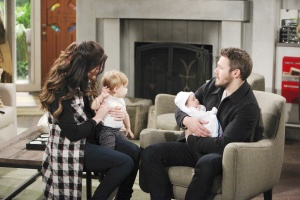 Liam holding baby Phoebe, Steffy holding baby Kelly on Bold and the Beautiful