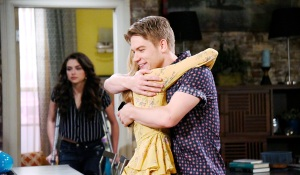 tripp and claire hug while ciara watches