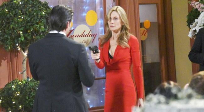 Kristen holds a gun to Eric