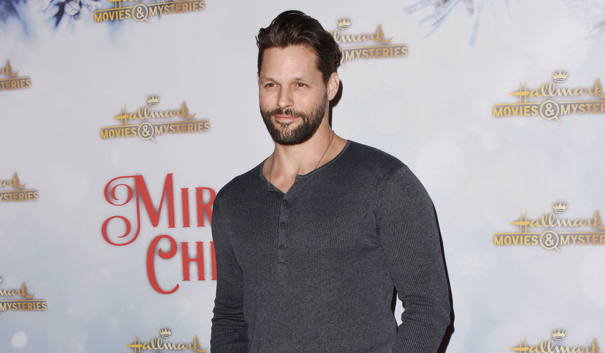 AMC alum Justin Bruening at holiday party 2018