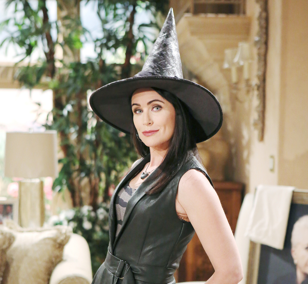 Quinn in witch hat on Halloween