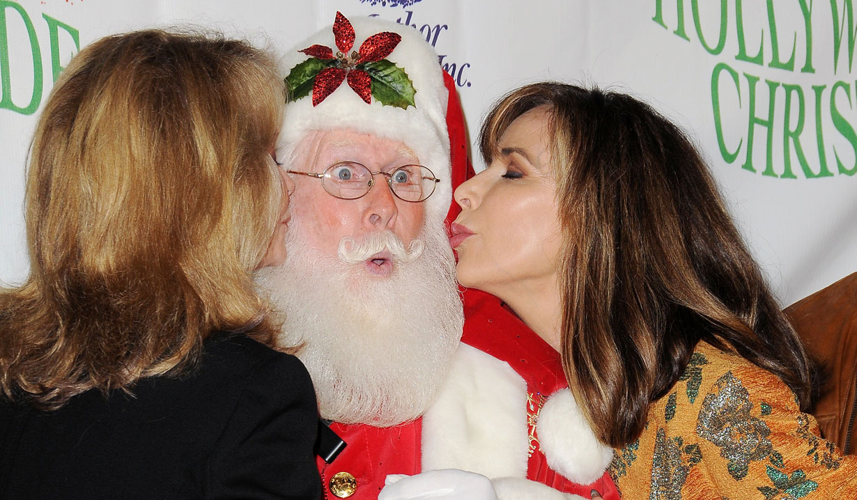 Deidre Hall & Lauren Koslow kissing Santa at Hollywood Christmas Parade