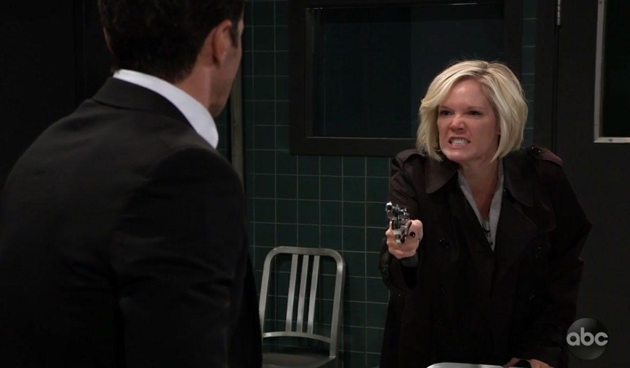 Ava holds a gun on Griffin