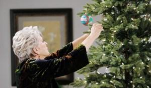 julie trims horton christmas tree