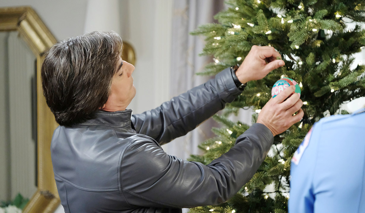 lucas puts his bulb on the horton christmas tree