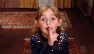 Katie hushes someone
