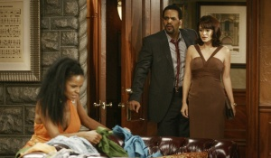 Dru cuts Carmen's clothes