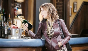 Kate looking at champagne on Days of our Lives