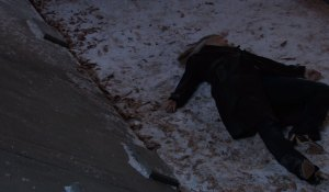Carly lies lifeless in snow