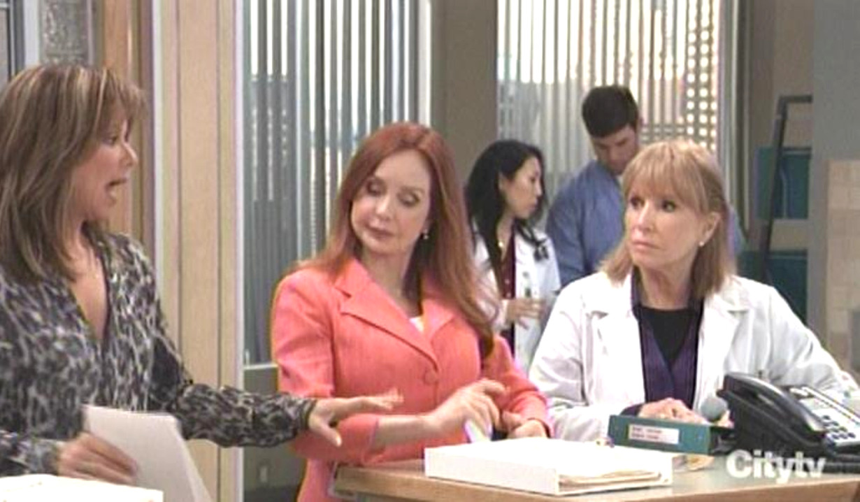 Alexis hands out envelopes from Gail general hospital