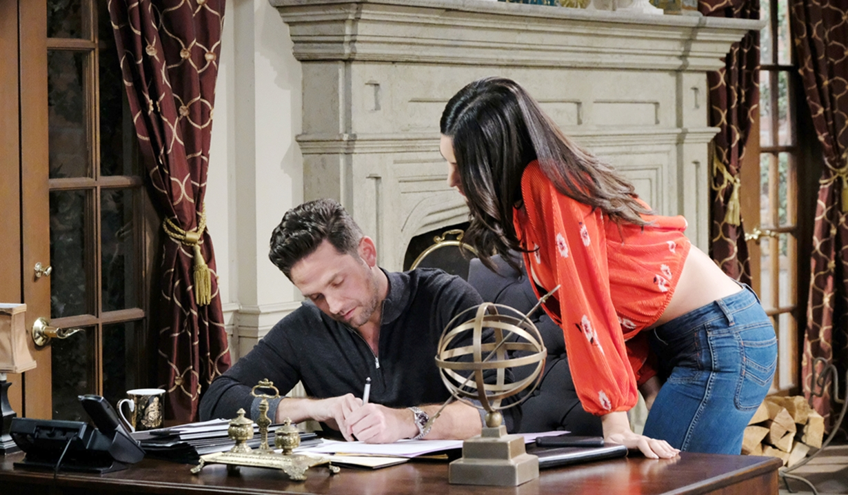 Gabi watches Stefan sign papers on Days of our Lives