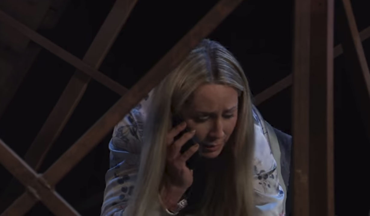 Joss panicked on the phone on the bridge General Hospital