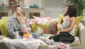 Liam and Steffy hold babies Bold and Beautiful