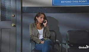 Lily on phone with Cane Young and Restless