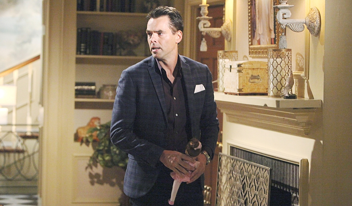Billy holds doll in mansion Young and Restless