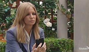 Christine contemplates her phone Young and Restless