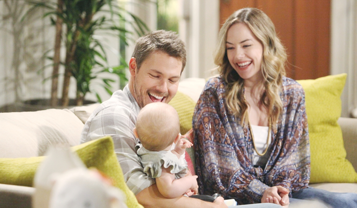 Hope and Liam hold Phoebe on Bold and Beautiful