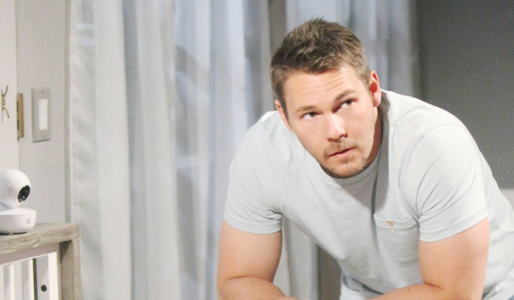 liam stands over baby crib on bold and beautiful