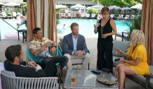 The cast enjoy drinks poolside on BH90210