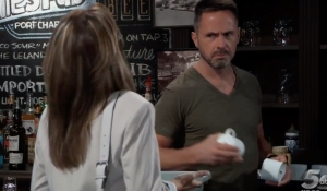 Julian looks skeptical of Alexis on General Hospital