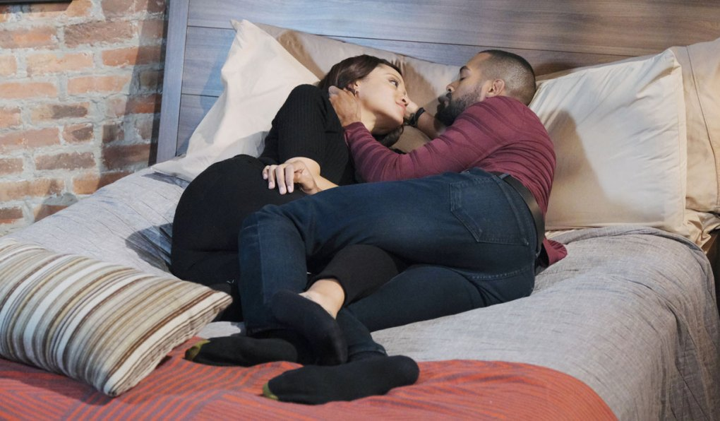 eli and lani lie in bed on days of our lives