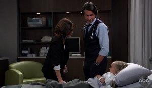 Hayden and Finn look over Violet on General Hospital