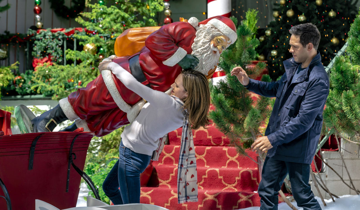 Nikki DeLoach carries santa, Michael Rady in Hallmark's Two Turtle Doves