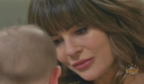Sarah looks at baby Days of our Lives
