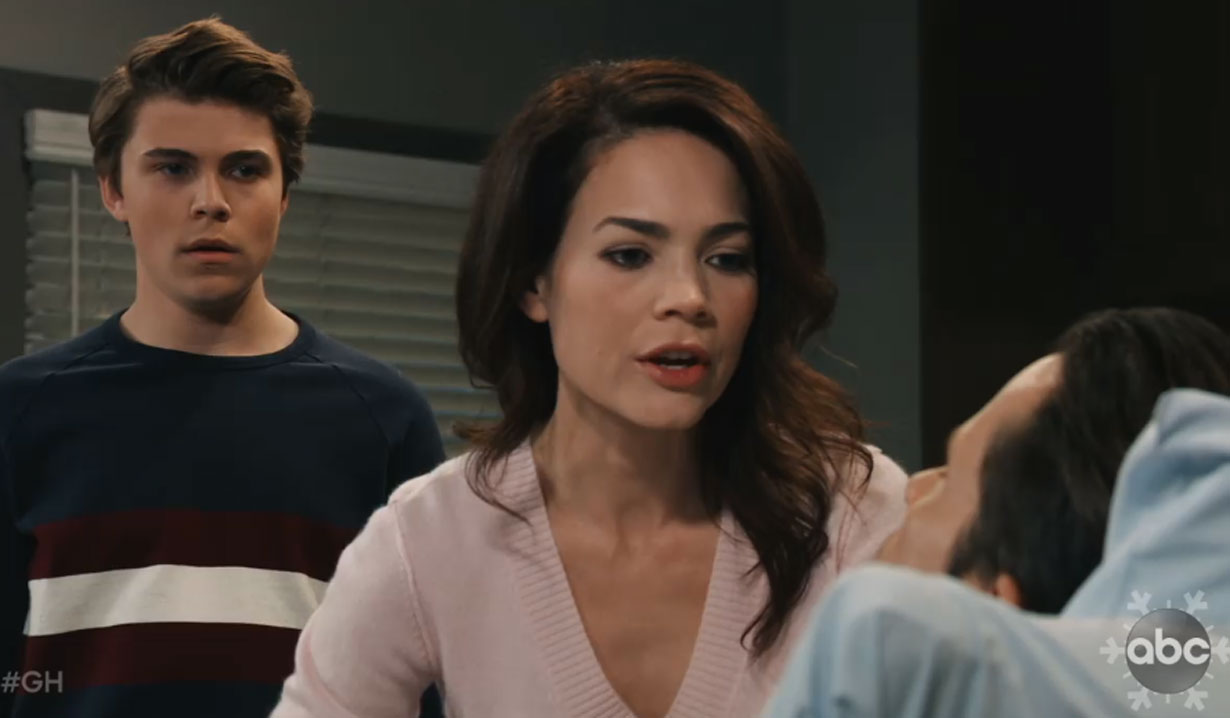 cameron and liz watch franco open his eyes after procedure on general hospital