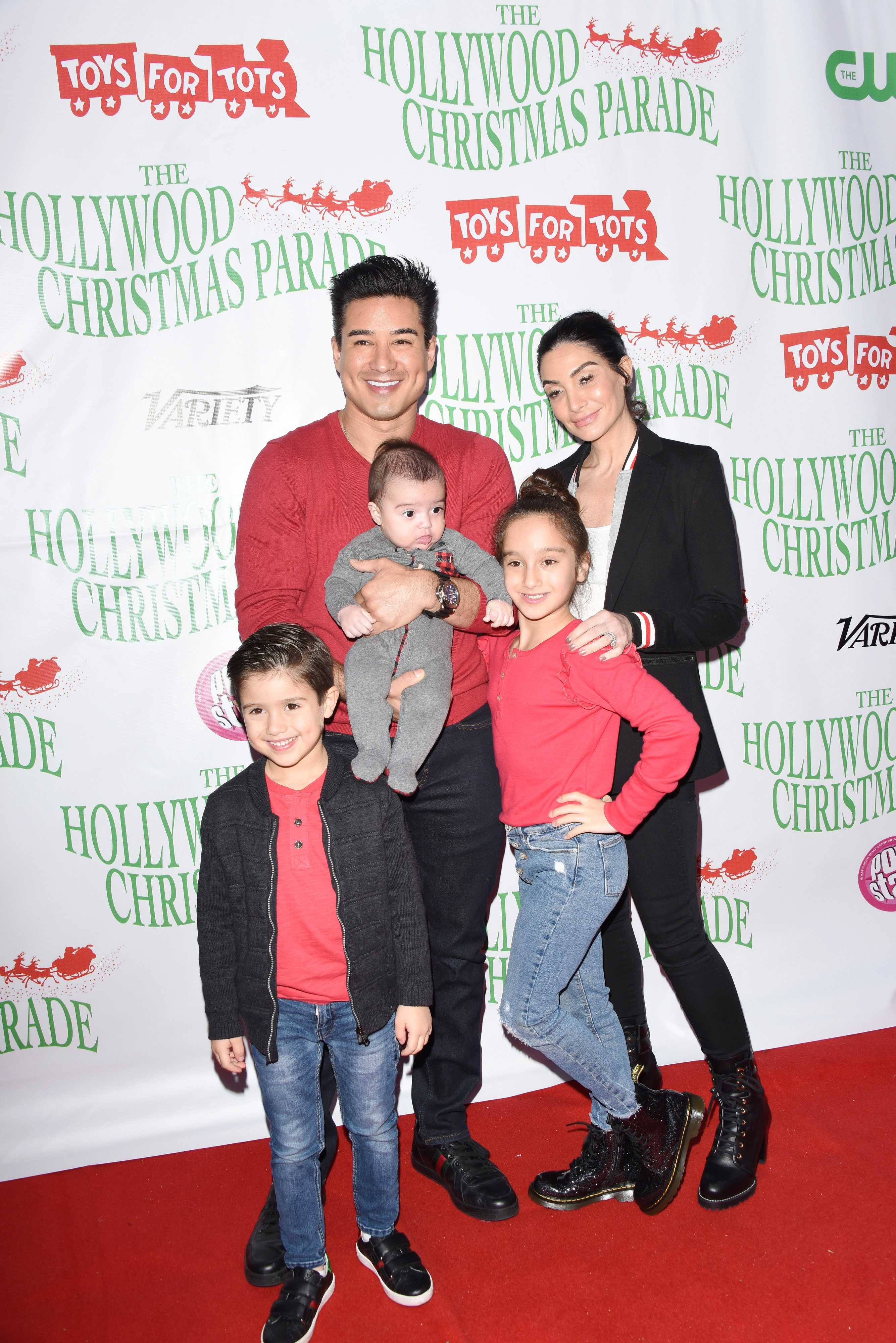 Mario Lopez,Courtney Mazza,Dominic Lopez,Gia Lopez,Santino Lopez attends the 88th annual Hollywood Christmas Parade