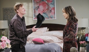 Roman holds boot up to Kate on Days of our Lives
