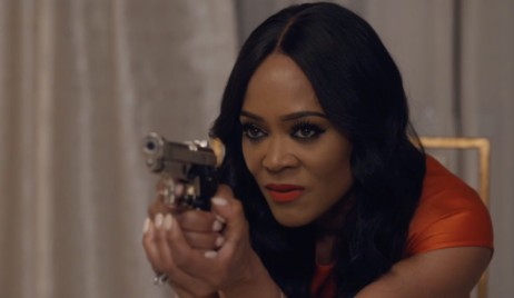 Stephanie points a gun at Evan on Ambitions