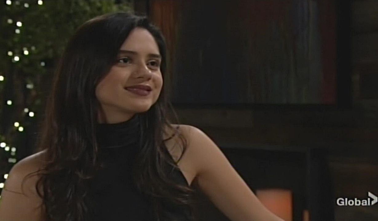 Lola smiles at Kyle Young and Restless