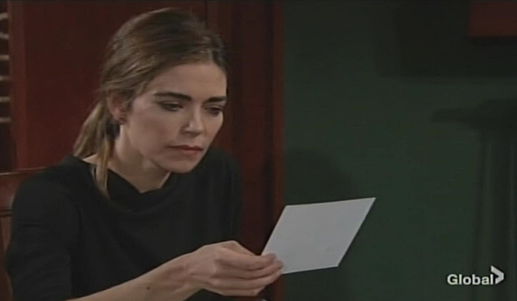 Victoria looks at photo Young and Restless