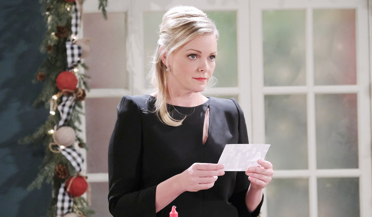 Belle pensively looks up from photo on Last Blast Reunion