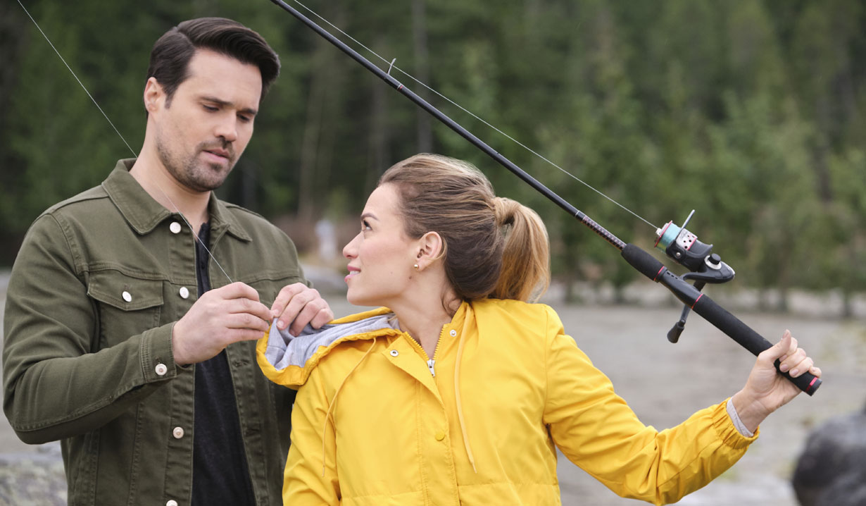 Vanessa and Martin fishing Hallmark's Just My Type
