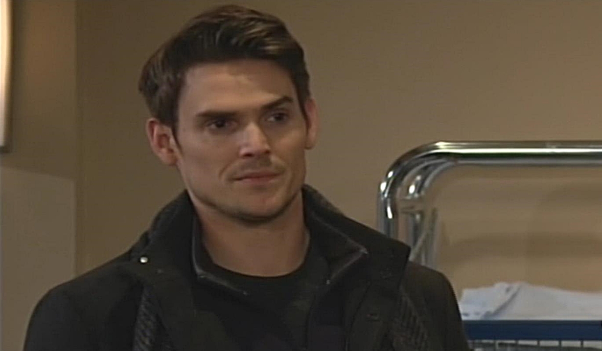 Adam looks at Victor Young and Restless