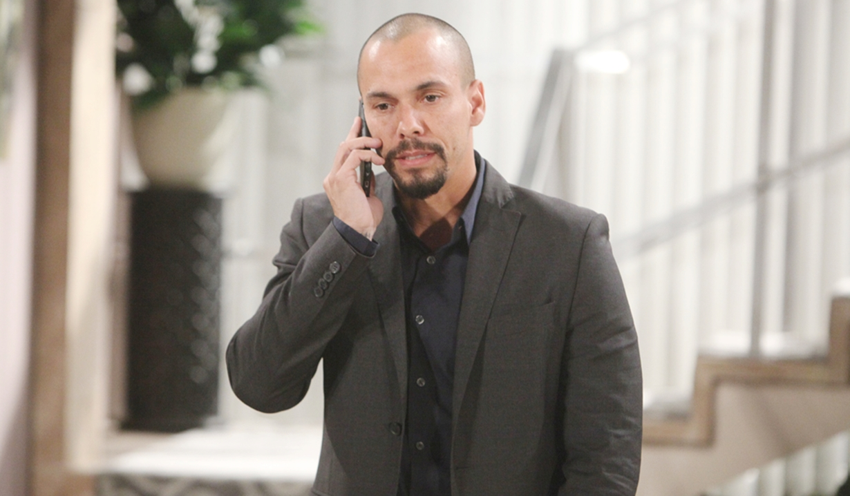 Devon on phone Young and Restless