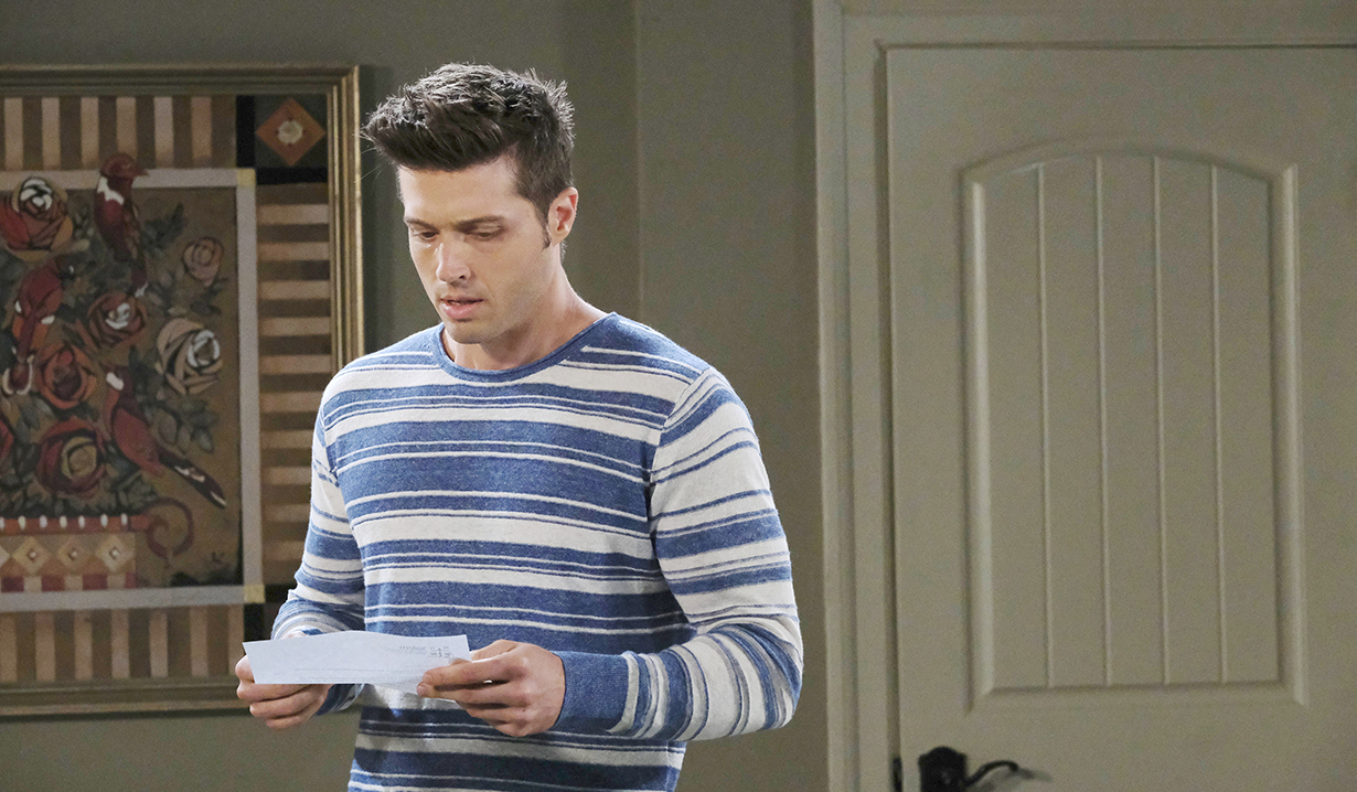 evan looks at a paper, worried days of our lives