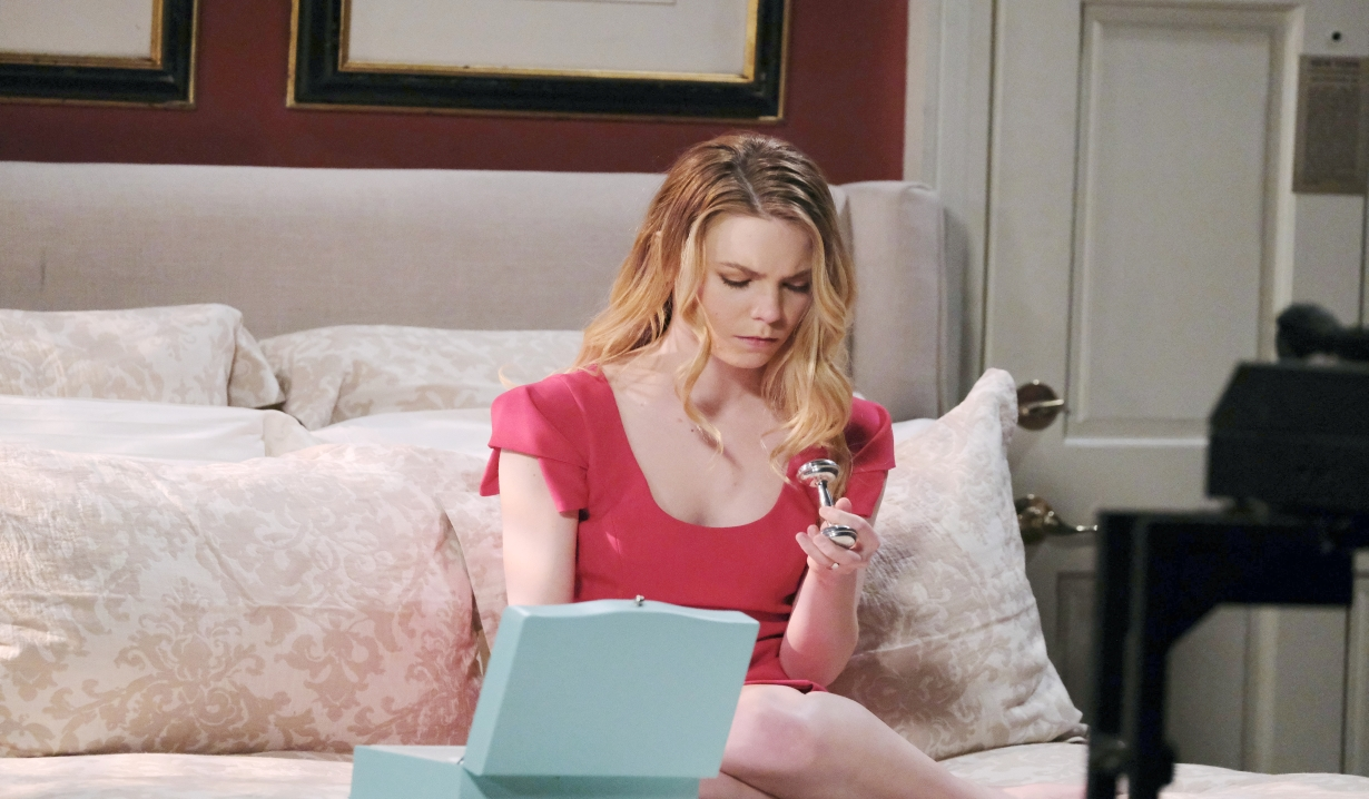 Nelle in her room with locket and rattle General Hospital